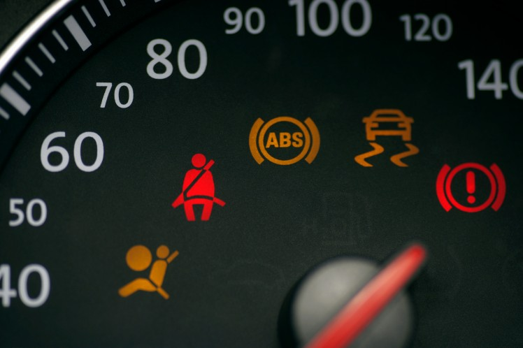 Car speedometer with illuminated seat belt sign
