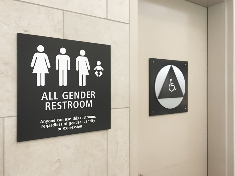 Multi gender bathroom signage in airport.jpg
