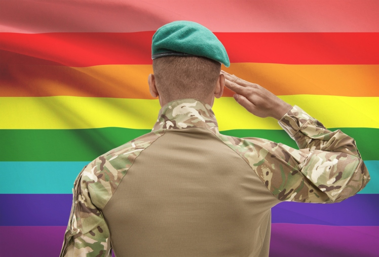 Dark-skinned soldier with flag on background - LGBT people